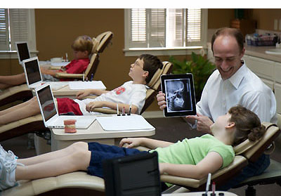 orthodontist with patient